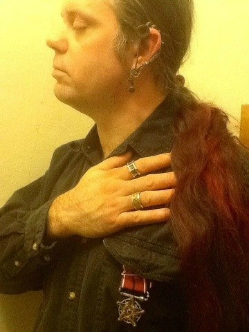 Me, with Steampunk rings, Master's Voice earring, and Occult Industrial Star medal